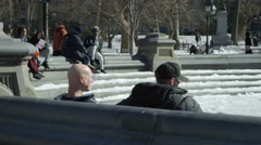 friends sitting frozen fountain circle Washington Square Park 4K Manhattan NYC - stock footage