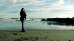 Girl looking ocean in tempest slow motion wide shot Stock Footage