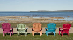 4K Time lapse shadow over colored chairs at lake - stock footage