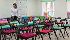 Staff works for preparing room for consefence or seminar holding - stock footage