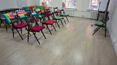 Colorful room for meeting with arranged chairs and flipchart on the floor Stock Footage