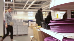 Customers walk between Ikea shelves with furniture accessories - stock footage
