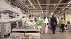 Shelves with goods are in Ikea store showroom.  Stock Footage