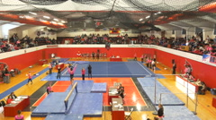 4K wide shot of womens college gymnastics meet Stock Footage
