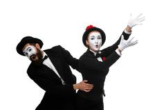 mime holding another one up and running - stock photo