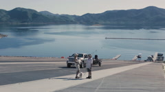Shot of a truck coming up a boat ramp on a lake Stock Footage