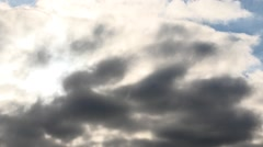 The sun appears from behind the clouds time lapse Stock Footage