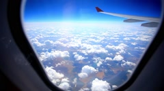 Looking through window aircraft during flight in wing with a nice blue sky. HD Stock Footage