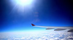 Looking through window aircraft during flight in wing with a nice blue sky and Stock Footage