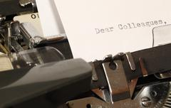 Letter with a title Dear Colleagues typed on old typewriter - stock illustration