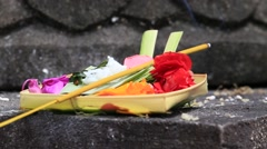 Traditional balinese offerings to gods in Bali with flowers and aromatic sticks Stock Footage