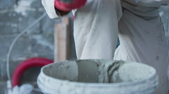 Masonry cement on trowel close up - stock footage
