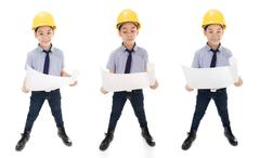 Young asian child construction engineer Holding equipment - stock photo
