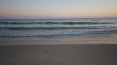 Ocean waves on the shore, sunset, peaceful scene Stock Footage