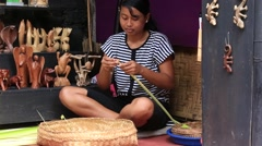 Girl make baskets for balinese traditional offerings to gods . Bali, Indonesia Stock Footage