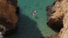 Kayaking between the atlantic rocks Stock Footage