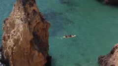 Pair in kayak over turquoise water Stock Footage