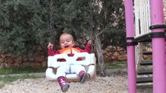 Active baby on swing Stock Footage