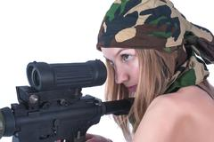 Beautiful young woman aims on sniper rifle Stock Photos