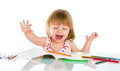 Little baby girl draws pencil Stock Photos