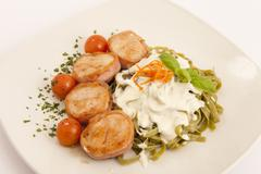 Round chicken with pancetta and tagliatelle - stock photo