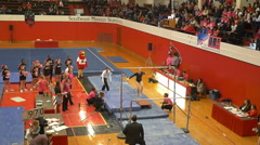 Time lapse of female college gymnast doing entire parallel bar routine Stock Footage