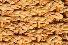 Abstract decorative wooden textured basket weaving background. Stock Photos
