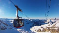Titlis Rotair cableway cars passing each other Stock Footage