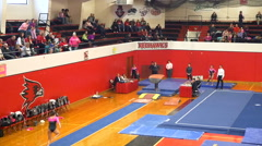 Womens college gymnastics slow motion vault Stock Footage