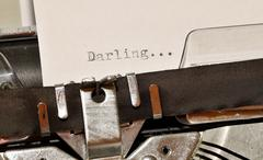 Darling word on white paper typed on old black typewriter - stock photo