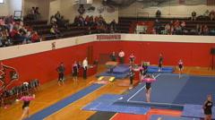 Extreme slow motion college female gymnastics vault Stock Footage