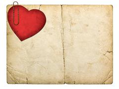 old paperboard card with red paper heart isolated on white background - stock photo