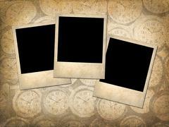 Three Polaroid style photographs on a grungy vintage background Kuvituskuvat