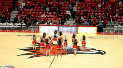 College dance team performing on basketball court Stock Footage