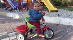 Stock Video Footage of Charismatic Baby on his bike
