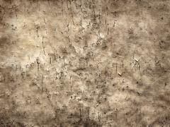 Old cracked sheet of parchment in grunge style  as background Stock Photos