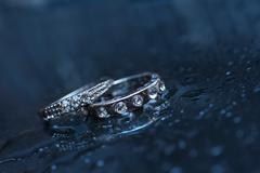 Two wedding rings on a blue background Stock Photos