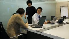 Business team working together in boardroom of office - stock footage