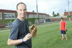 Portrait of a young baseball player in a field Stock Photos