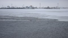 Ice melting on water storage reservoir Stock Footage