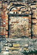 Arch of an old brick wall of a house Stock Photos