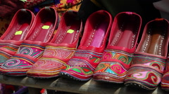 Indian market, collection of woman leather shoes for sale,traditional handicraft - stock footage
