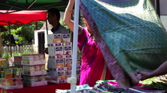 Beautiful woman wearing sari,Indian flea market,silk,cashmere,fabric,customer Stock Footage