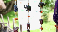 Elephant and beads good luck charm, amulet, Feng Shui, figurine, wind chimes - stock footage
