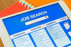 Digital tablet pc showing user interface of online job search Stock Photos