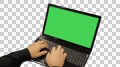 Man typing on laptop with green screen, Full HD shot Stock Footage