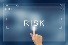 Hand press on risk button on website Kuvituskuvat