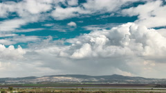 4k Time lapse of clouds in pure sky over the Galilee fields, Israel - stock footage