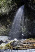 Beach waterfall - stock photo