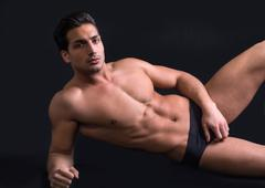 Handsome latin young man naked on floor Stock Photos